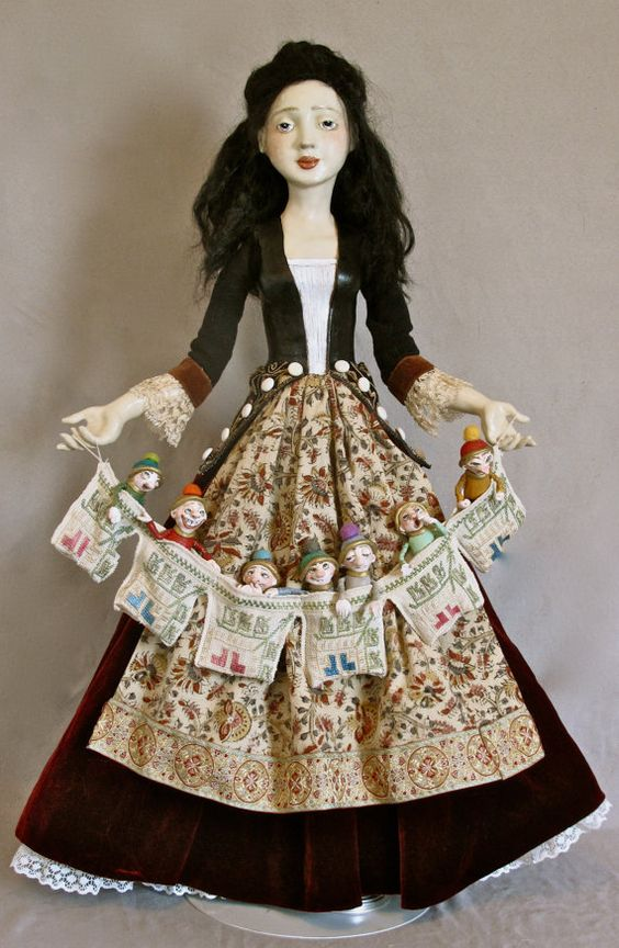 Lucia Friedericy is a doll artist who creates modern, intricate dolls in fairy tale themes. The costumes her dolls wear harken back to centuries past, but have a distinctive modern appeal.