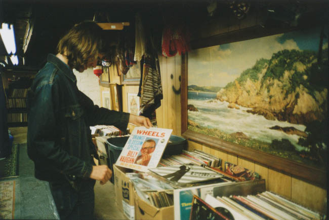 Man shopping for records at a thrift store.