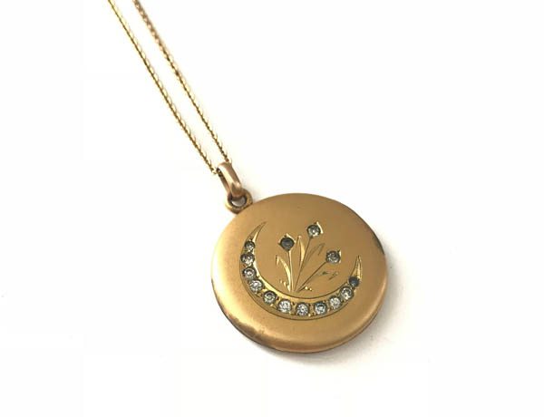 Crescent Moon Paste Locket offered by thayerstreetvintage on Etsy.