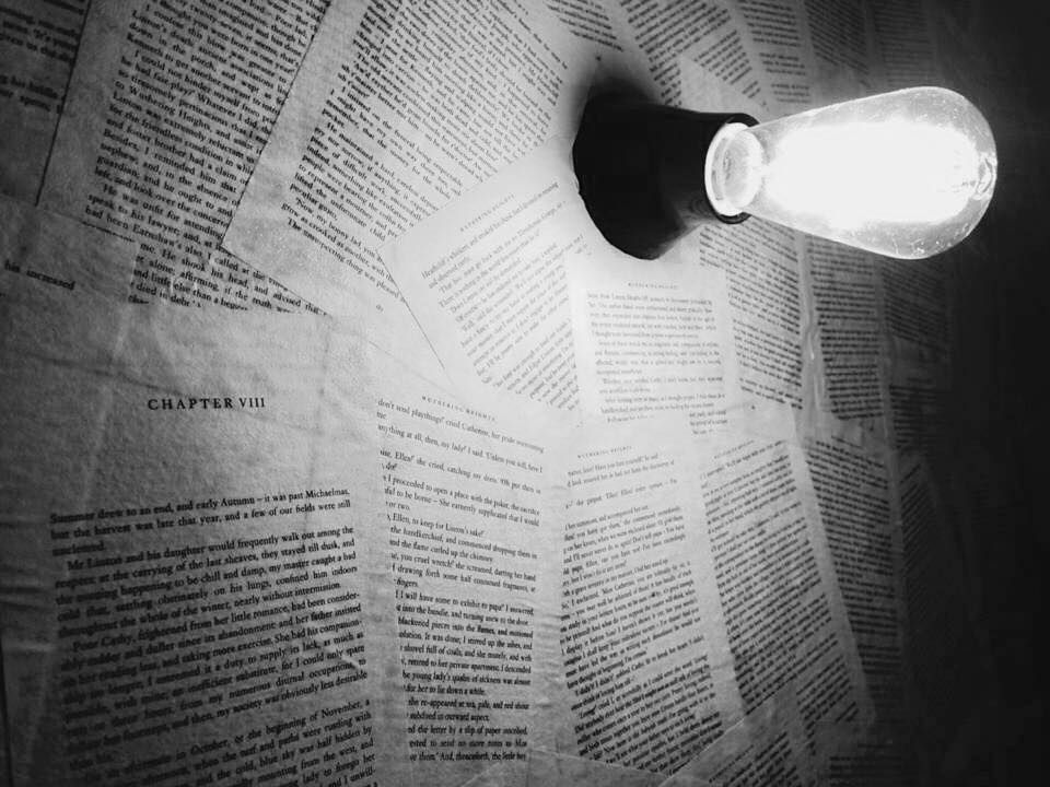 A wall at Emily's covered with pages from her novel, Wuthering Heights. (Photo credit: Emily's)