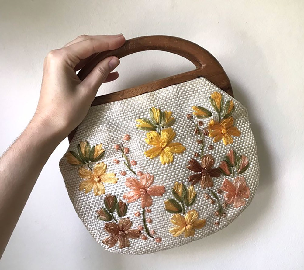Vintage floral raffia handbag with wood handle offered by TheSweetestVintage on Etsy