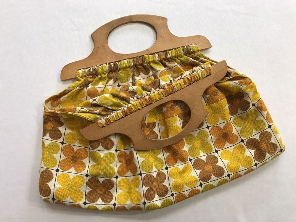 Vintage groovy floral bag with wood handle offered by TheOddOwl on Etsy