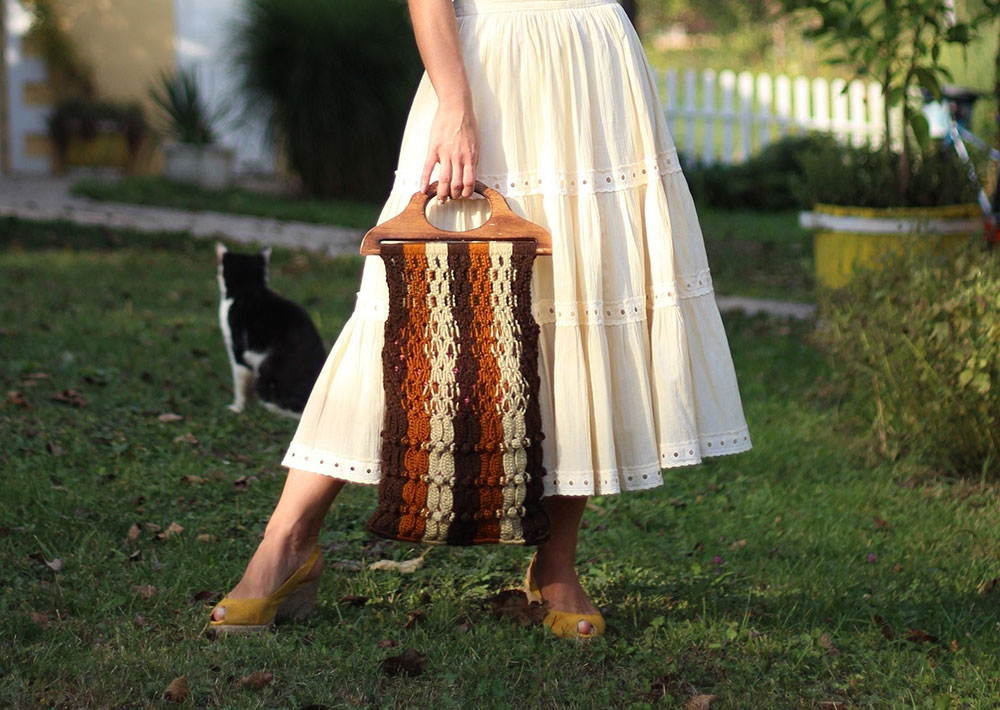 Vintage macrame bag with wood handle offered by PiafVintageStore on Etsy