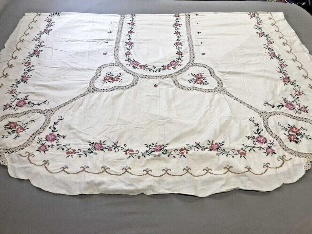 Large vintage tablecloth with rose embroidery and lace.