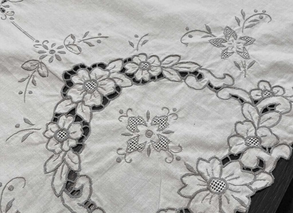 Vintage cream embroidered floral tablecloth.